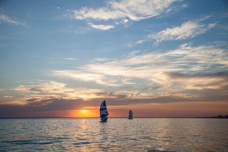 Two sailboats at sunset 스톡 콘텐츠