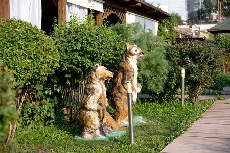 sculptures of bears in the garden