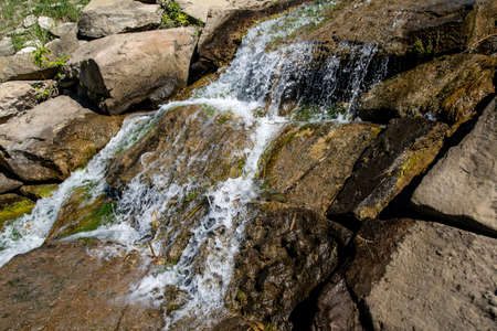 a small fresh water waterfall