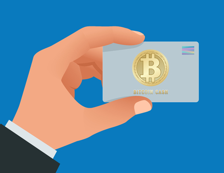 A man s hand holds a Bitcoin debit card. Account, credit, all in one card concept for bitcoin. Paying by Bitcoin to pay a bill. Digital currency money. Technology credit card bitcoin mining worldwide Illusztráció