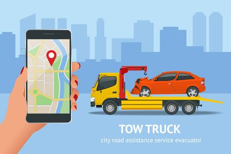 Tow truck, roadside assistance . Tow truck for transportation faults and emergency cars. The tow truck picks up the car on the penalty area Banque d'images - 131215200