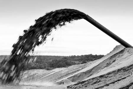 Industrial sand mining pumping out the pumping station. Black and white image. Background Imagens