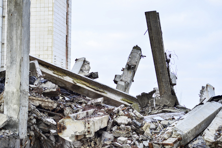 Remains of the destroyed industrial building. Large concrete piles continue to hold the body of the large concrete buildings, while others look at the sky.