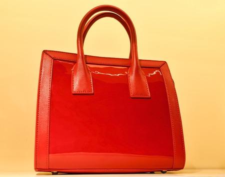 The red bag on the illuminated background. Redakční
