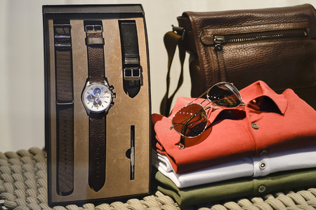 Composition mens stylish paraphernalia in the window in a shopping center, Kings Avenue MALL, Paphos, Cyprus, June 2017. The sharpness on the watch dial.
