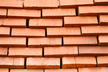Rows of red bricks ready for transport. Background.
