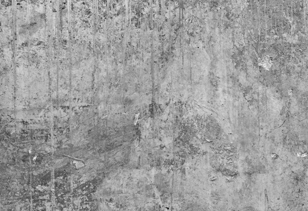 Part of the concrete wall with loose plaster of the old building. Black and white image. Stock Photo
