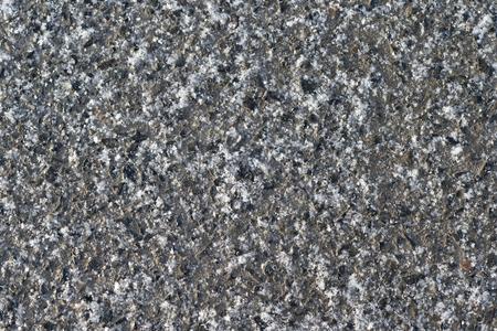 Texture abstraction of snow on an asphalt pavement Stock fotó
