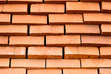 Rows of red bricks ready for transport. Background