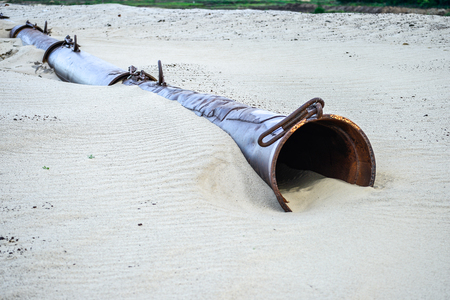 The remains of the pipe washing the sand in a sand quarry