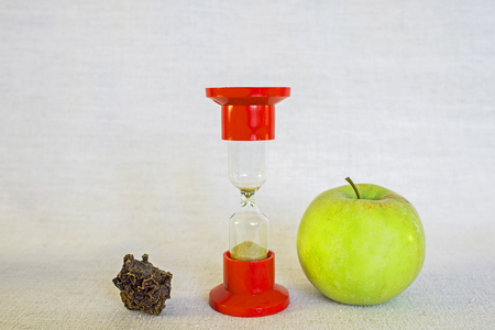 The concept of transformation of the original properties of a product or a person under the influence of time: withering, drying. Ripe Apple and dried into dried fruits entirely after a long time Stock Photo
