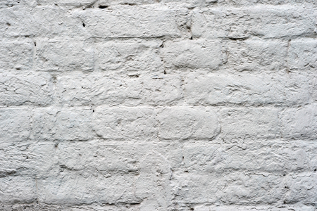 Brick wall painted with white paint with drawing the texture of bricks. Background.