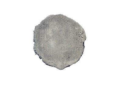An isolated fragment of a concrete wall on a white background. Detail the concept with place for inscription.