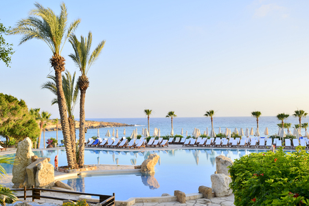 PATHOS, CYPRUS June 10, 2017. A number of sun loungers by the pool at the Coral Beach Hotel Resort Cyprus in June 2017 in Cyprus.