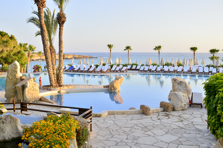 A number of sun loungers by the pool at the Coral Beach Hotel Resort Cyprus in June 2017 in Cyprus.