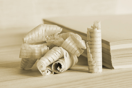 The stack sizing of paper with a symbol shaped chips of wood. The concept of using natural resources. Rendered image.