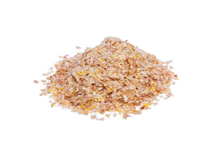 Corn bran is stacked in a pile on an isolated white background