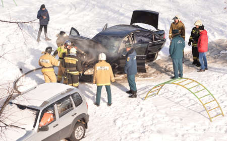 Firefighters pour a hydrant into a black Mercedes that caught fire, Zheleznogorsk, Kursk region, Russia, February 2021.