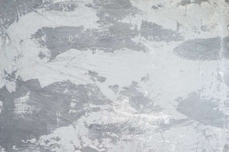 The painted wall is light to dark in grayscale gradients. Background