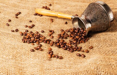 turk: fragrant coffee beans on the burlap with turk Stock Photo