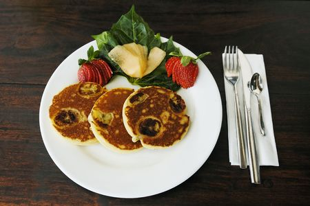 pancakes on a plate on a wood made table 스톡 콘텐츠