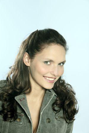 studio shot portrait of a beautiful 25 years old smiling woman Stok Fotoğraf - 121743278