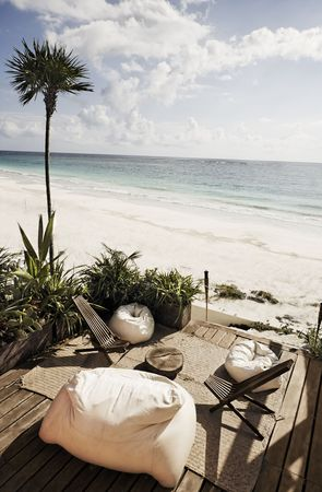 terrace of a cabana with a view of the beautiful white sand beach of tulum in yucatan mexico 스톡 콘텐츠 - 121743293