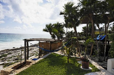 terrace of a cabana with a view of the beautiful white sand beach of tulum in yucatan mexico Banque d'images
