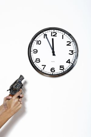 gun pointing black and white clock at five to twelve isolated on a white background