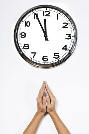 hands in front of a clock  isolated on a white background