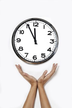 hands open in front of a clock isolated on a white background Stok Fotoğraf
