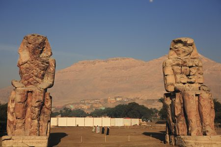 view of the Colossi of Memnon representing Amenhotep III in luxor upper egypt
