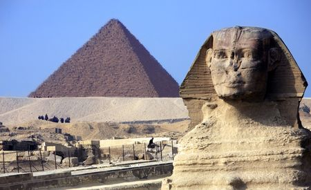 view of the sphynx with the pyramids of gizah near cairo in egypt Archivio Fotografico