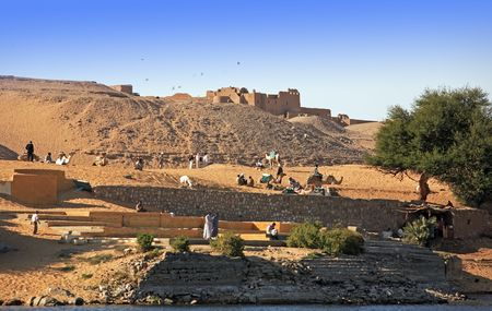 nubian village on the shore of the river nile in egypt Stock Photo