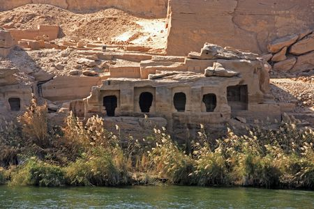 Cliff Dwelling troglodytes house on the shore of the river nile in egypt Stock Photo