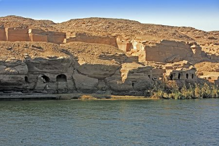 Cliff Dwelling troglodytes house on the shore of the river nile in egypt Фото со стока