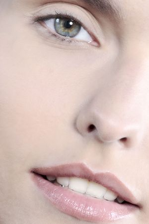 studio shot close up detail of the face of a beautyful young women with perfect lips mouth and teeth smiling Stock fotó