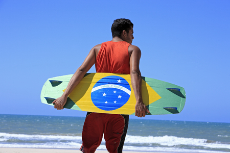 Kite surfer with the brazilian flag painted on the board with Zdjęcie Seryjne - 121743570
