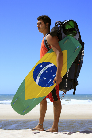 Kite surfer with the brazilian flag painted on the board with 版權商用圖片 - 121743574