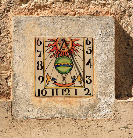 sundial of the typical south east of france old stone village of ramatuelle near saint tropez on the french riviera
