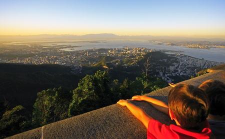 kids watching the panorama view of rio de janeiro from the corcovado christ redeemer site i brazil