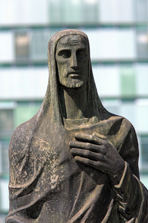 statue of jesus christ in front of the cathedral of brasilia city capital of brasil