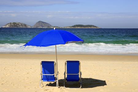 blue deckchair on ipanema beach de janeiro brazil