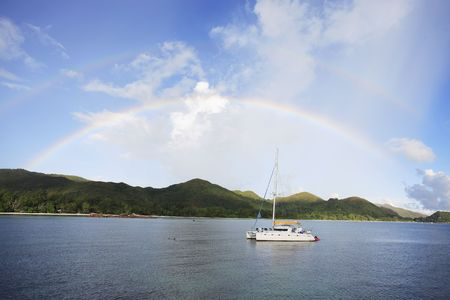 two rainbows over saint anne bay at praslin one of the seychelles island