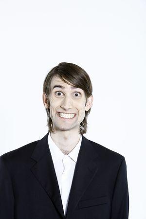 studio-opname portret van een jonge grappige expressieve dunne en lange man op geïsoleerde achtergrond Stockfoto