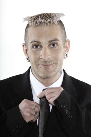 studio shot of isolated picture of a strange caucasian businessman with piercing and tattoos 写真素材 - 121743138