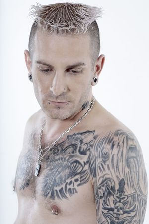 portrait of a caucasian man with piercing and tattoos