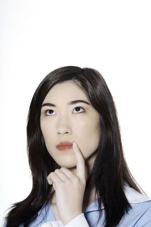 studio shot isolated portrait of a young cute and thinking asian woman