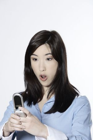 studio shot isolated portrait of a young cute asian woman calling by phone