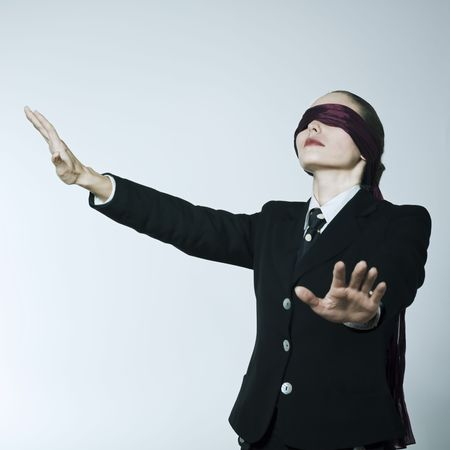 studio shot portrait of a beautiful young blindfold woman in a costume suit Stock Photo - 2966744